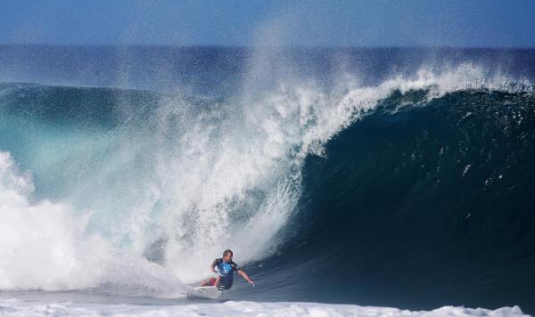 Taj Burrow aims for the barrel at Pipe.
