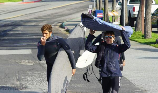 Lucas Chianca and Carlos Burle, headed to the boat for the swell at Maverick's, Jan 26, 2017.