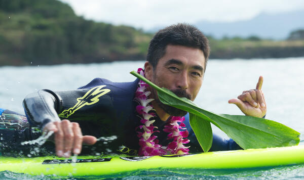 Takayuki Wakita paddles out for The Quiksilver In Memory of Eddie Aikau 2014 opening ceremony.
