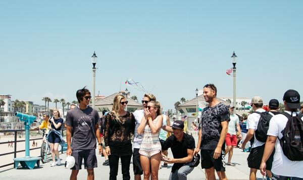The engagement took place on the pier during the Vans US Open