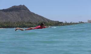 Sallas paddles out during the 2015 Duke's Waikiki Kane Longboard Pro