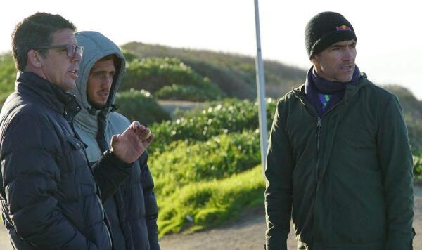Lucas Chianca, Pete Mel and Carlos Burle looking at waves in Santa Cruz Jan. 27, 2017.