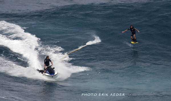 Kai Lenny's first day at Jaws with Dave Kalama on the ski. Photo by Erik Aeder.