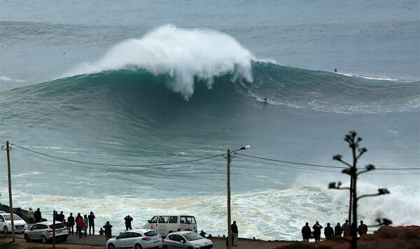 Ross Clarke does his fair share of snowboarding in the winter months, so this Nazaré bomb was just a warm-up routine for his heel-side carves. Photo: Vitor Estrelinha/WSL Big Wave Awards