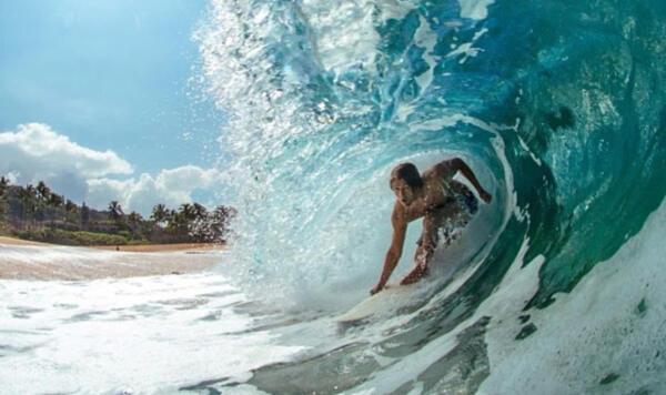 Joe Turpel gets barreled in the shorebreak.