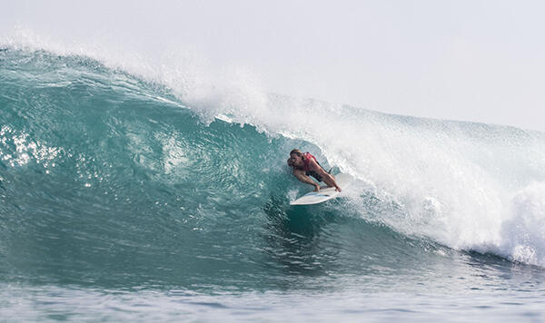 Jared Neal (AUS) finding a near-perfect 9.17 Tupira barrel in Round Two of the Kumul PNG World Longboard Championships.