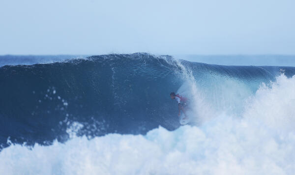 Filipe Toledo finds a tube at Backdoor in Round 2.