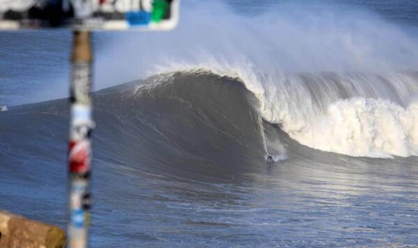Have you ever done a bottom turn? Odds are Mick Corbett's is a bit more extended than yours. Photo by André Botelho